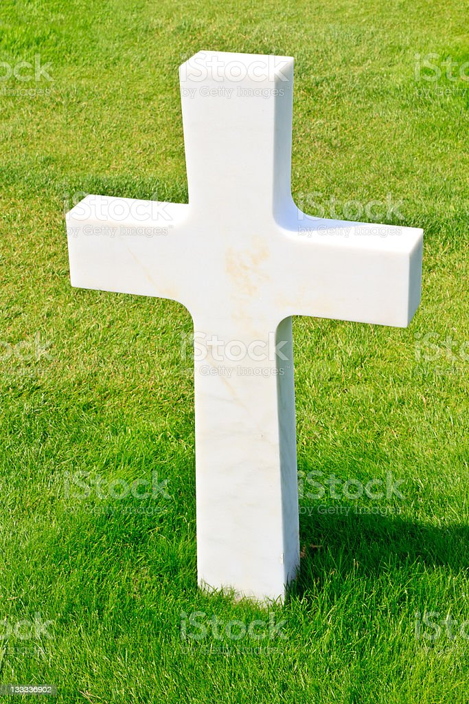 Marble Cross of fallen Soldier, American War Cemetery near Omaha royalty-free stock photo