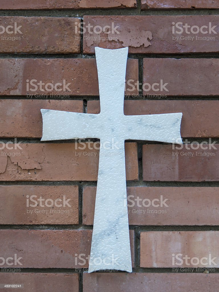 marble cross on red brick royalty-free stock photo