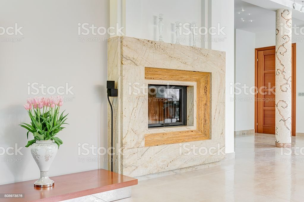 Marble fireplace in lounge stock photo