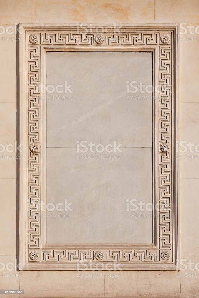 Marble frame on external wall of a church in Rome royalty-free stock photo