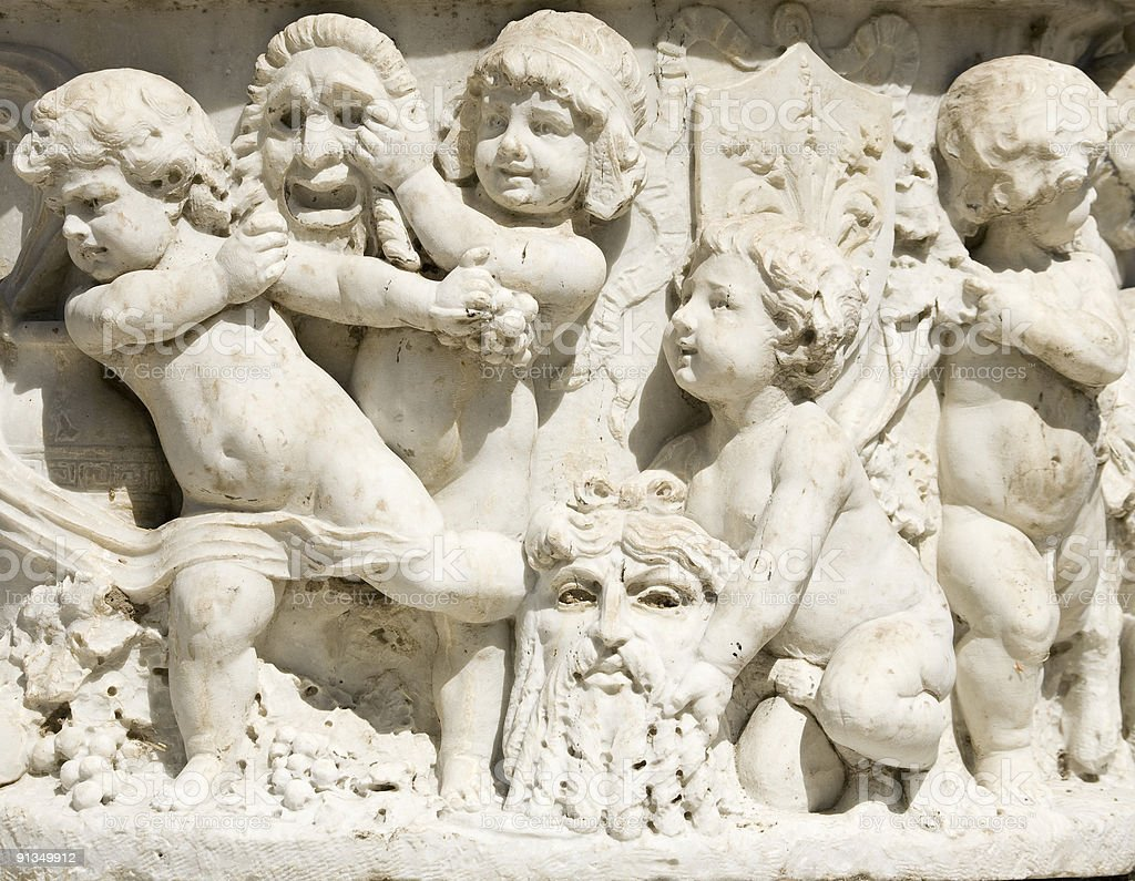 Marble Frieze of Children with Theatrical Comedy and Tragedy Masks royalty-free stock photo