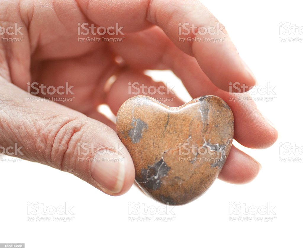 marble heart in hand stock photo