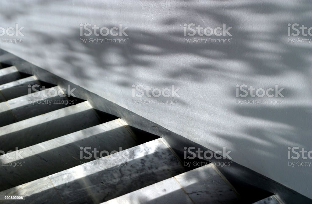 Marble ladder and wall with shadows stock photo