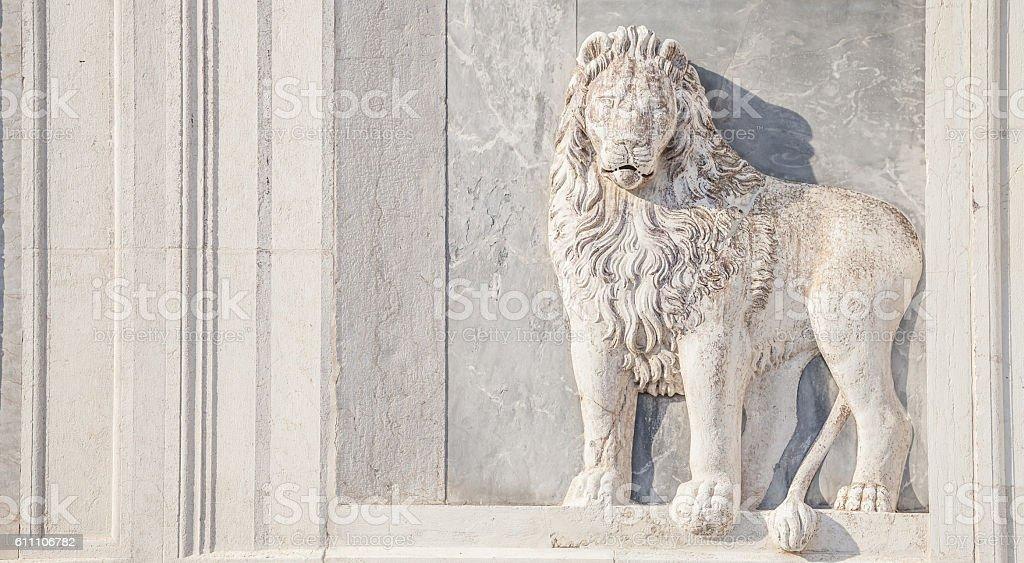 Marble lion on church facade stock photo