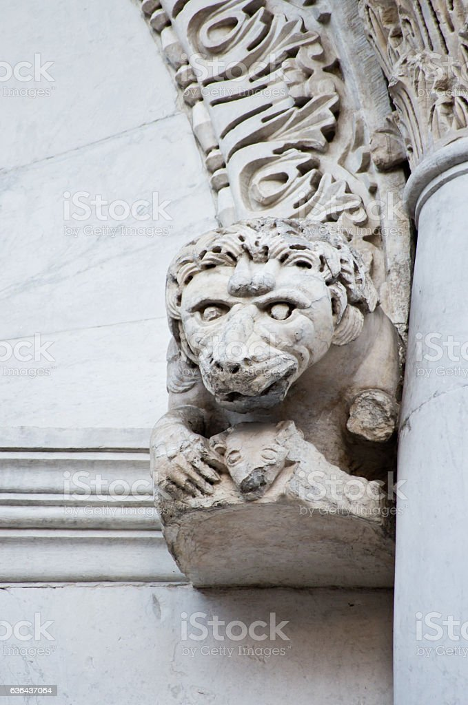 marble lion on the old church site stock photo