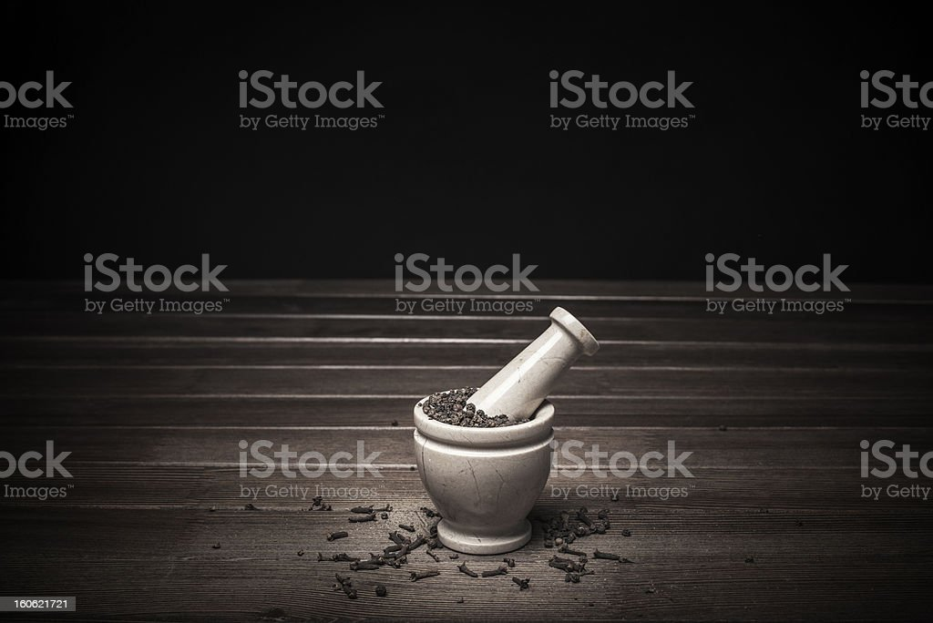 marble mortar with spices black pepper and carnation royalty-free stock photo