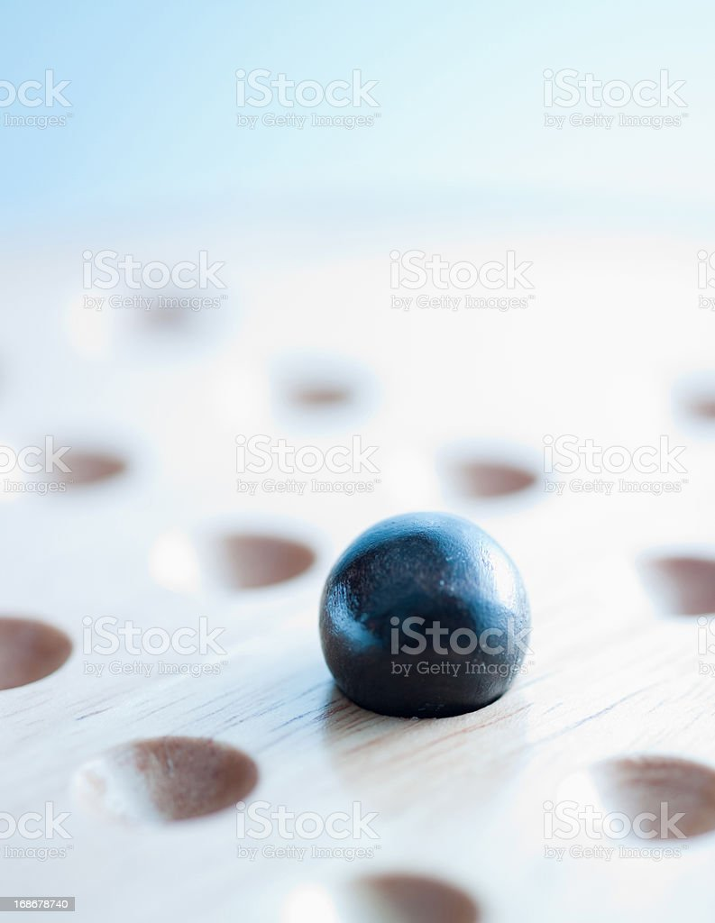 Marble on Chinese checkers board stock photo