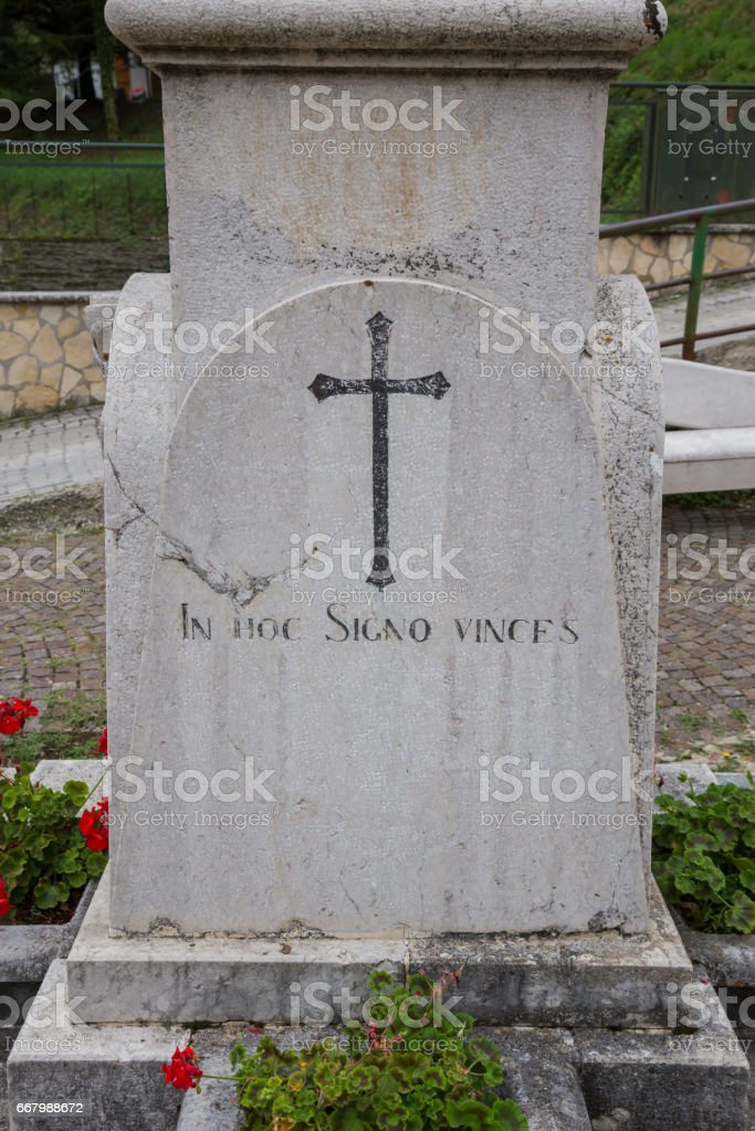 Marble plaque with Latin inscription and the cross stock photo
