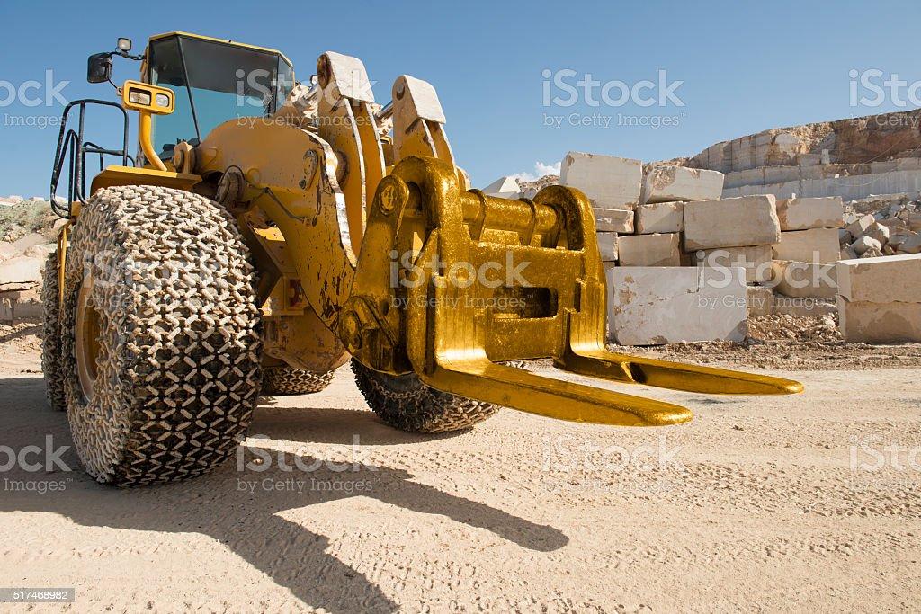 Marble Quarry working Excavator stock photo