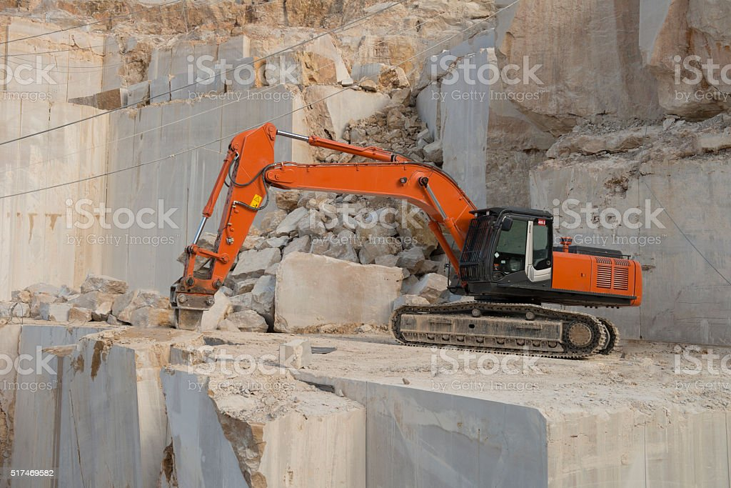 Marble Quarry working Excavator stock photo