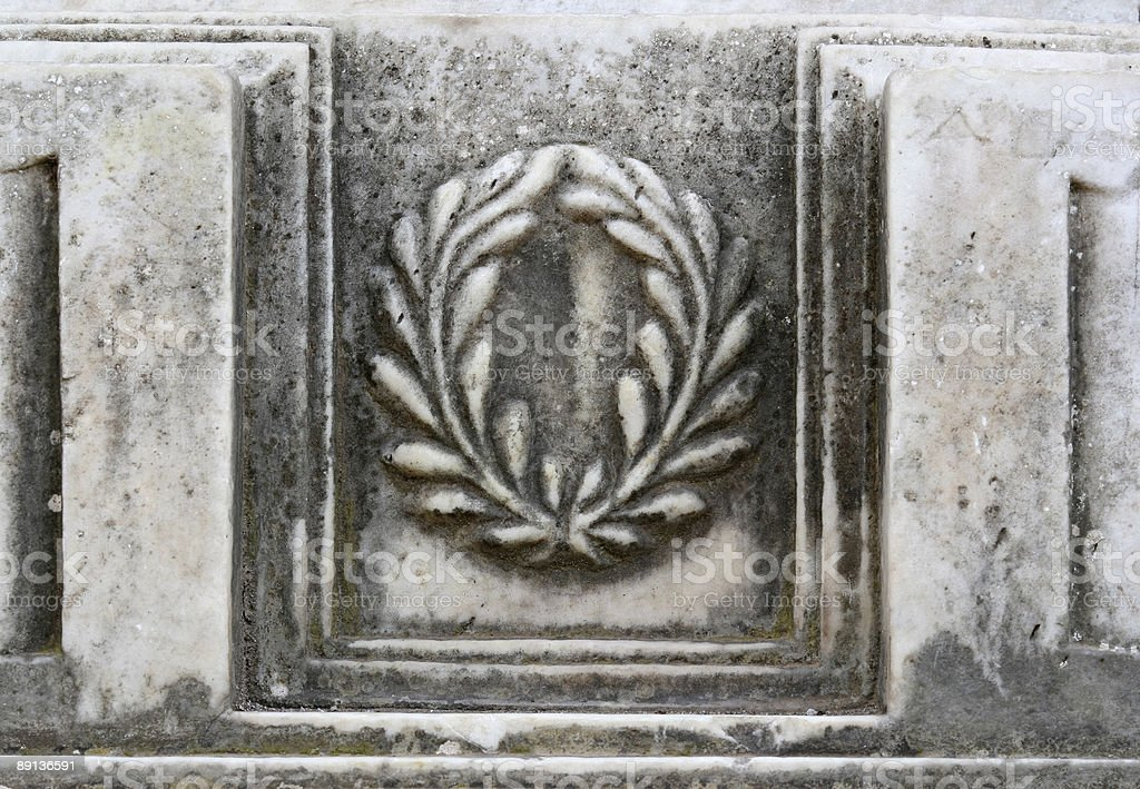 Marble relief of the Roman laurel wreath, Rome Italy royalty-free stock photo
