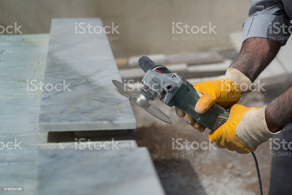 marble repair with angle grinder stock photo
