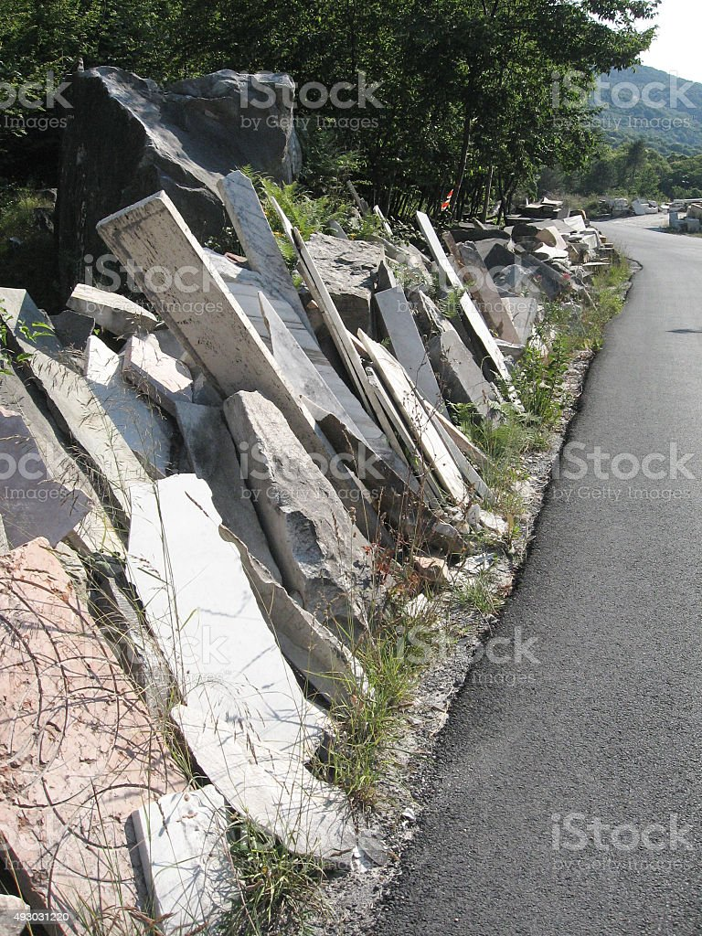 Marble slabs along the road royalty-free stock photo