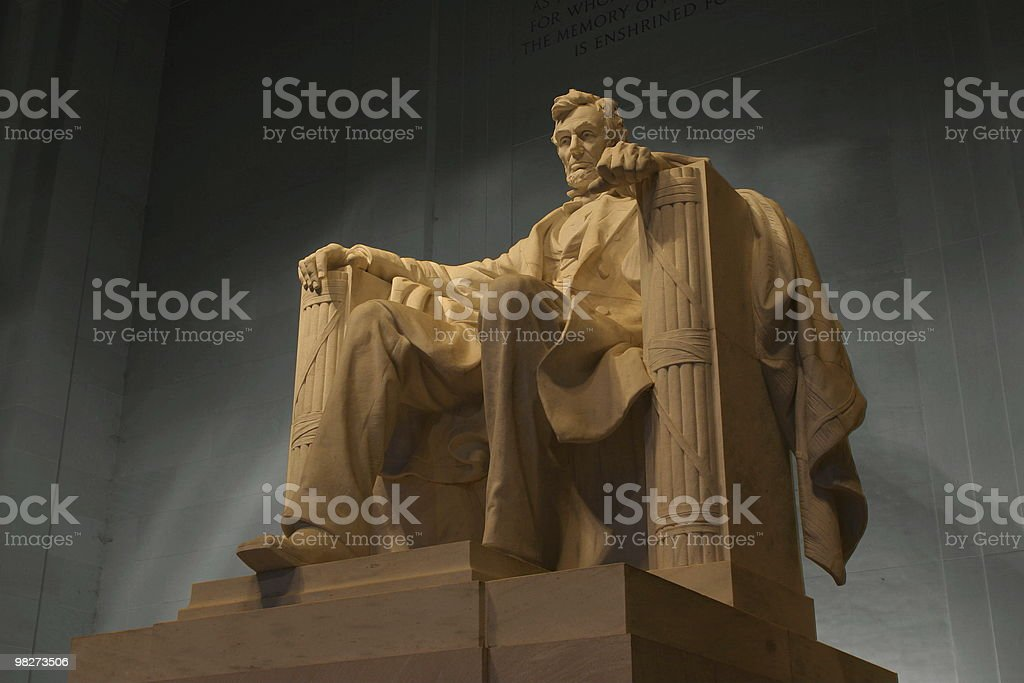Marble statue of Abraham Lincoln sitting again gray concrete stock photo