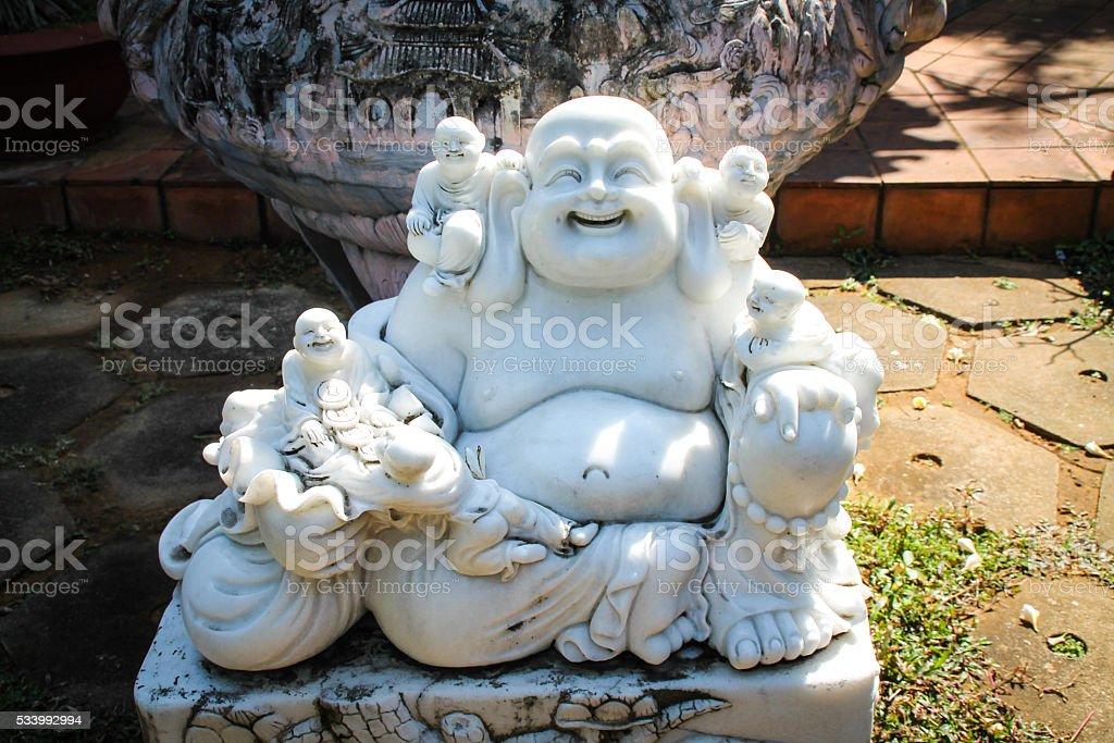 Statue de Budai en marbre photo libre de droits