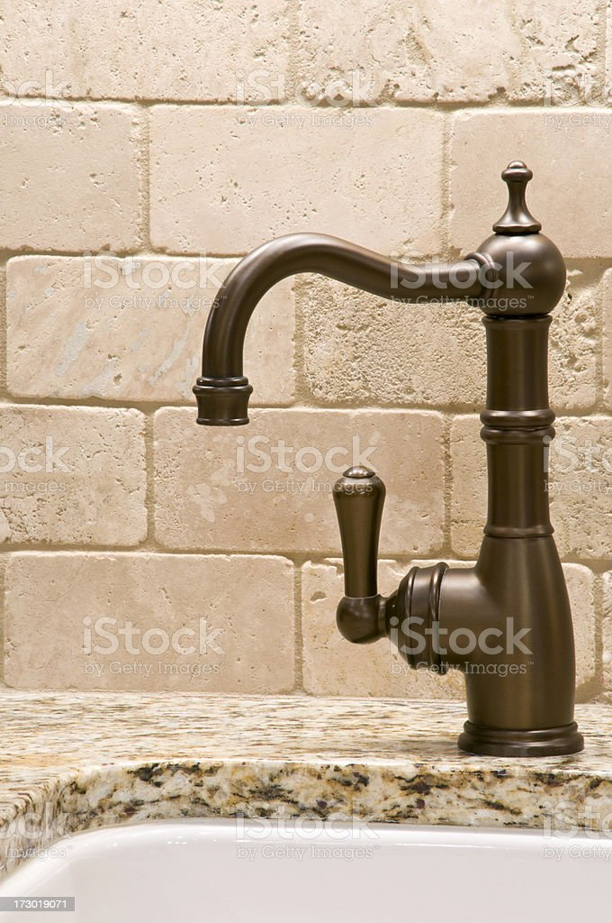 Marble top, faucet with brick back splash royalty-free stock photo