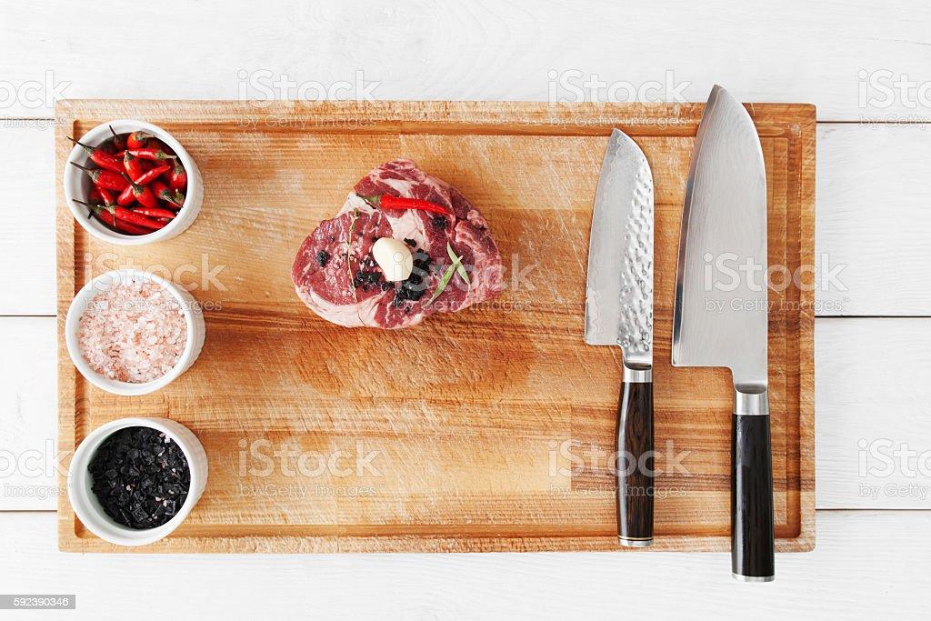 Marbled beef steak preparing, flat lay, close-up stock photo