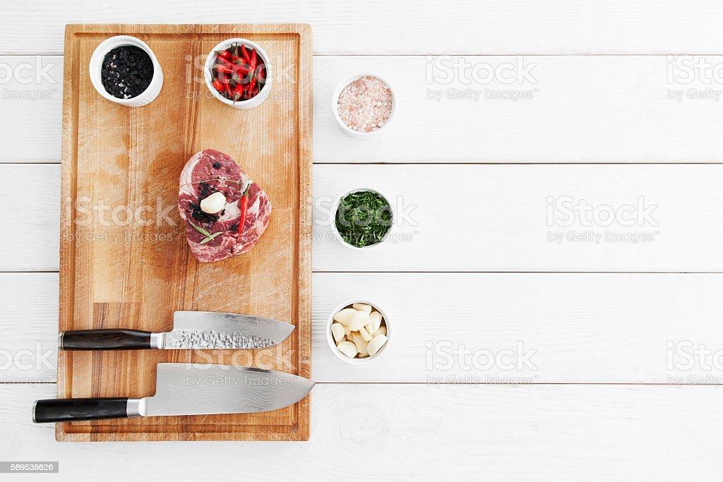 Marbled beef steak preparing, flat lay, copy space stock photo