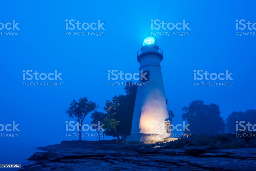 Marblehead Lighthouse in Fog with Light On stock photo