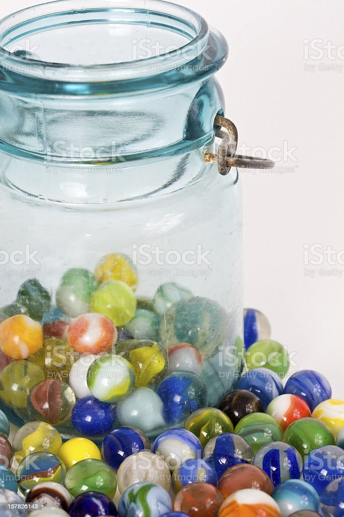 marbles and a jar stock photo