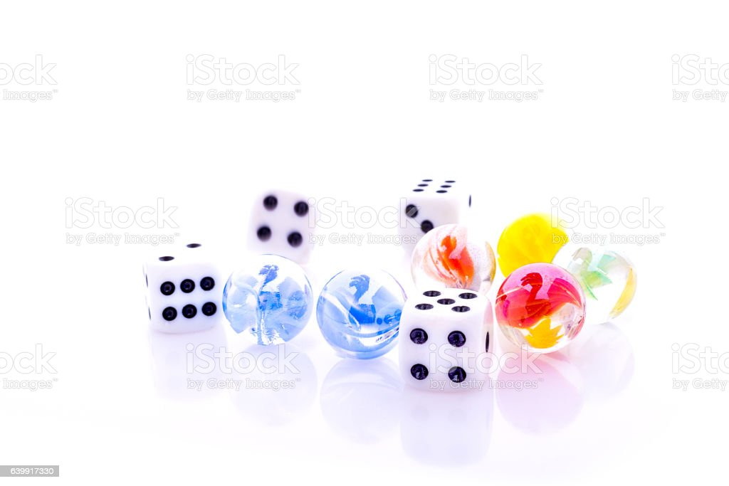 marbles with dices stock photo