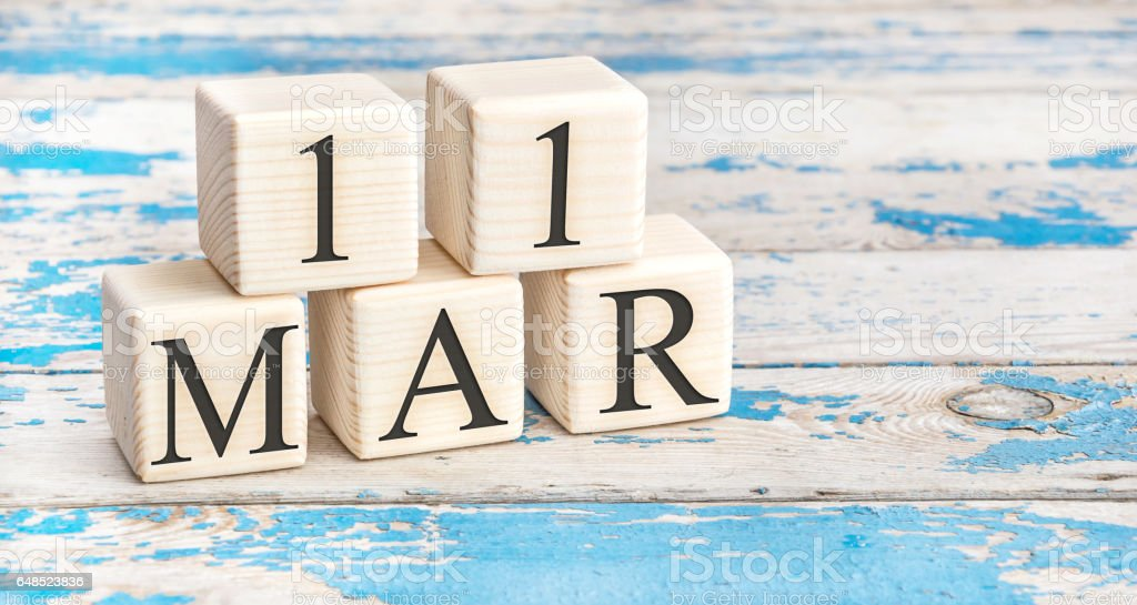 March 11th. Wooden cubes with date of 11 March on old blue wooden background. stock photo