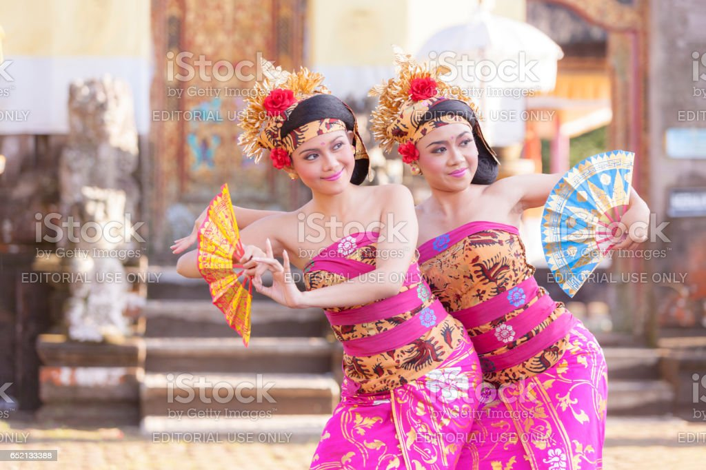 BALI - 6 March 2017 : girl performing traditional Indonesian dance at Ulun Danu temple Beratan Lake in Bali Indonesia on 6 March 2017  in Bali, Indonesia. stock photo
