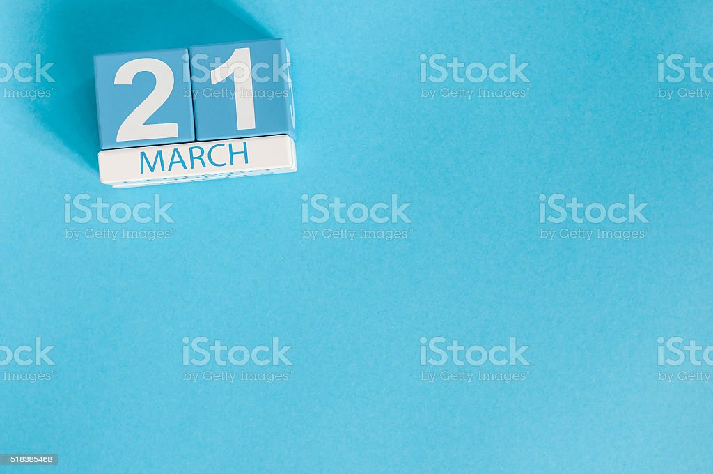 March 21st. Image of march 21 wooden color calendar on stock photo