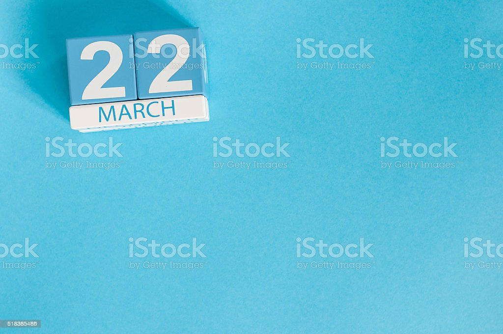 March 22nd. Image of march 22 wooden color calendar on stock photo
