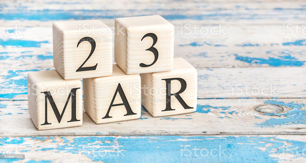March 23th. Wooden cubes with date of 23 March on old blue wooden background. stock photo