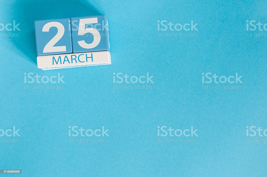 March 25th. Image of march 25 wooden color calendar on stock photo