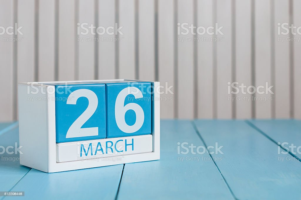 March 26th. Image of march 26 wooden color calendar on stock photo