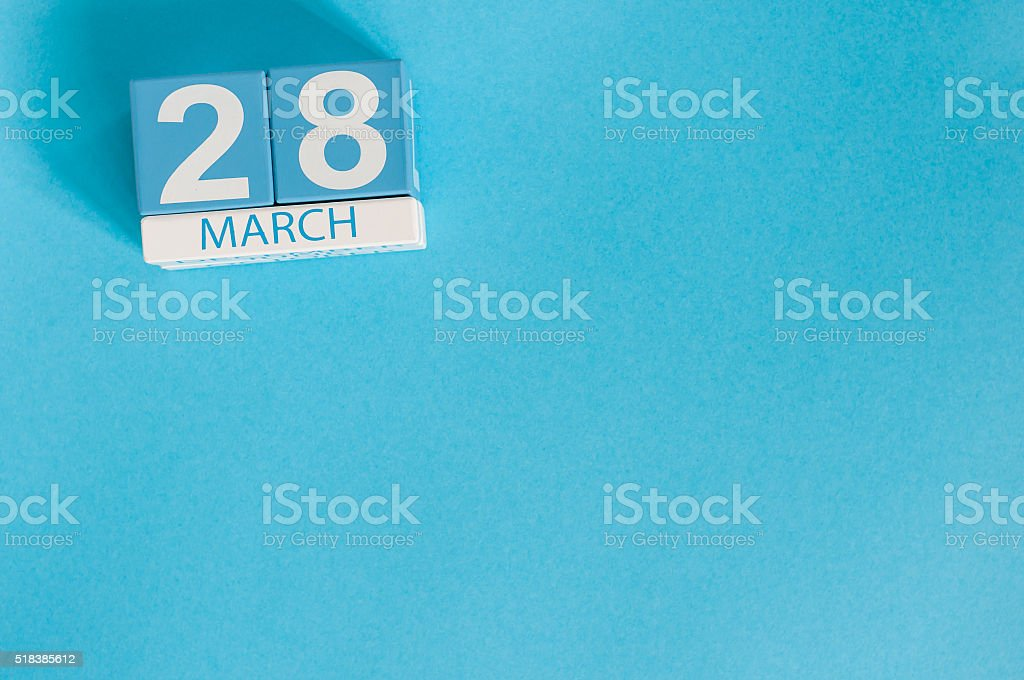 March 28th. Image of march 28 wooden color calendar on stock photo
