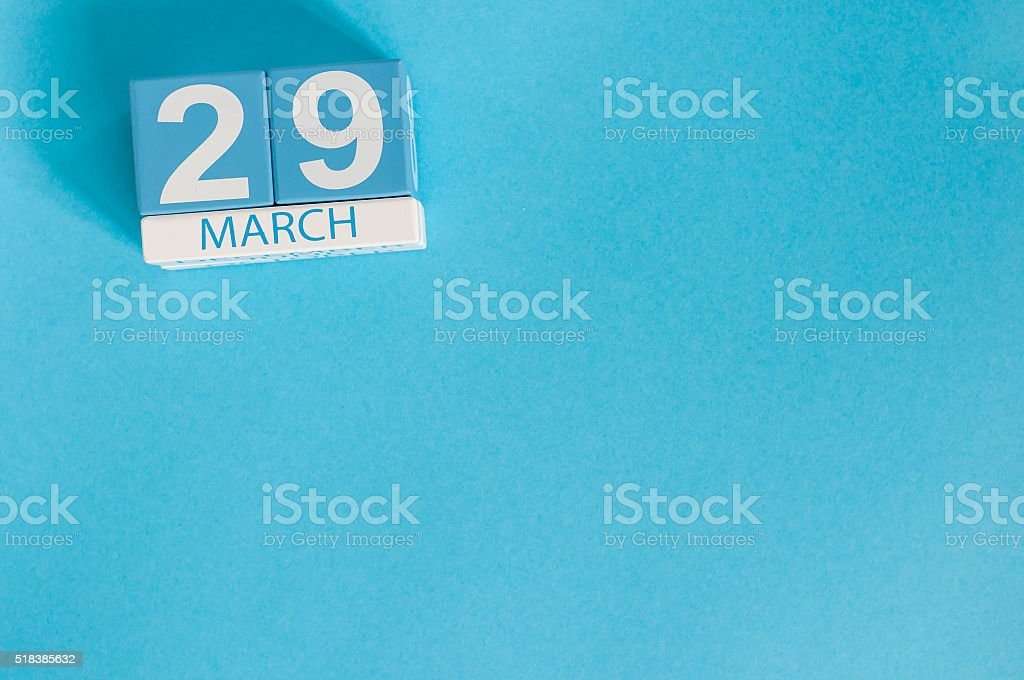 March 29th. Cube calendar for march 29 on wooden surface stock photo