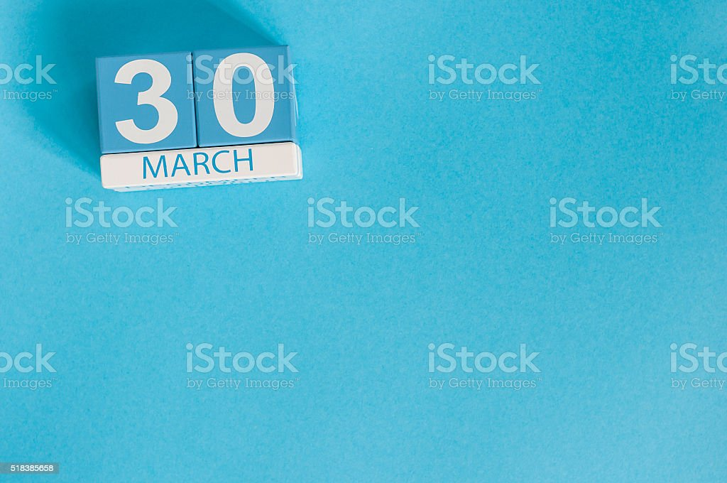 March 30th. Image of march 30 wooden color calendar on stock photo