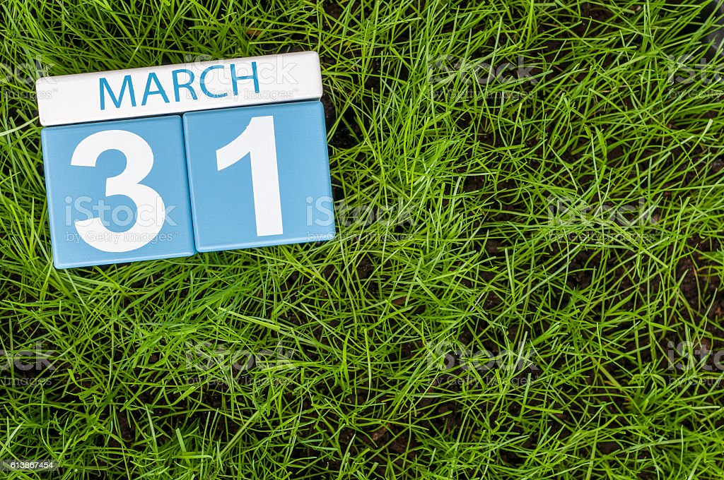 March 31st. Day 31 of month, calendar on football green stock photo