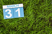 March 31st. Day 31 of month, calendar on football green