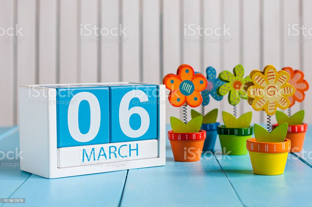 March 6th. Image of march 6 wooden color calendar with stock photo