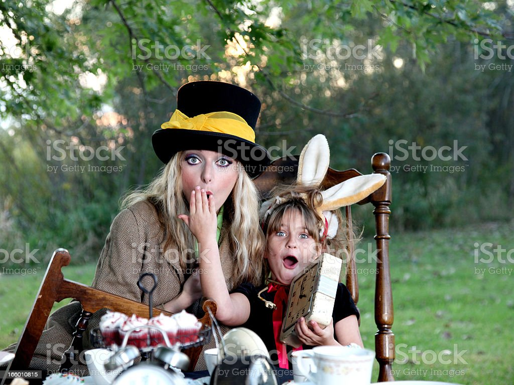 March Hare and Mad Hatter costume with clocks stock photo