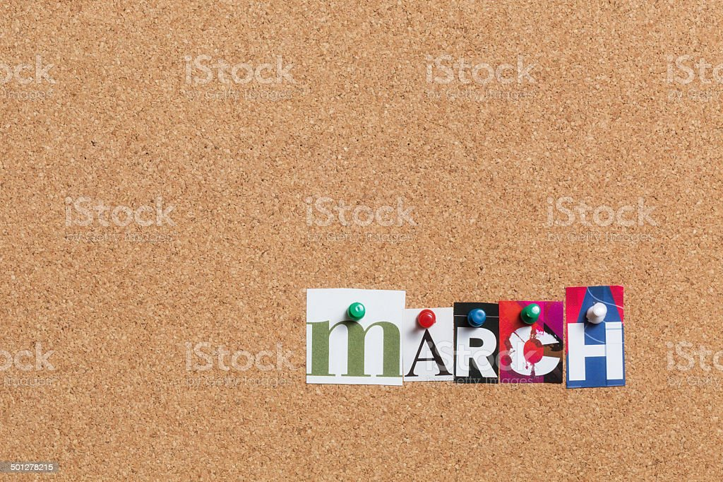 March pinned on bulletin cork board royalty-free stock photo