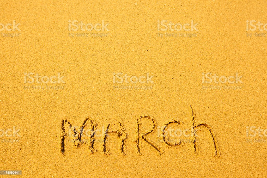 March - written in sand on beach texture royalty-free stock photo