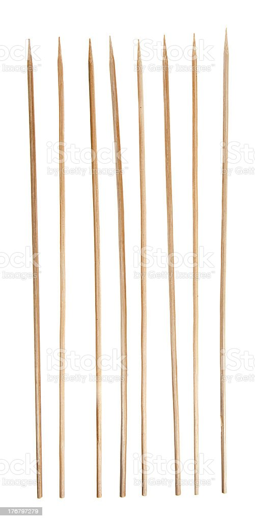 Marching Bamboo Skewers, Sharpened Sticks in Single Row, Isolated Background stock photo