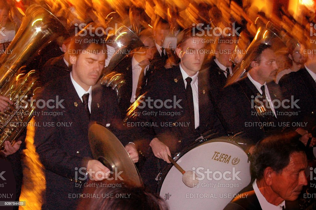 Marching band during a procession in the evening stock photo