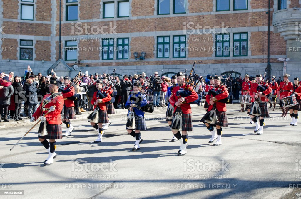 Marching Band of the Canadian Mounted Police with Bagpipes at the Quebec St-Patrick's Parade stock photo