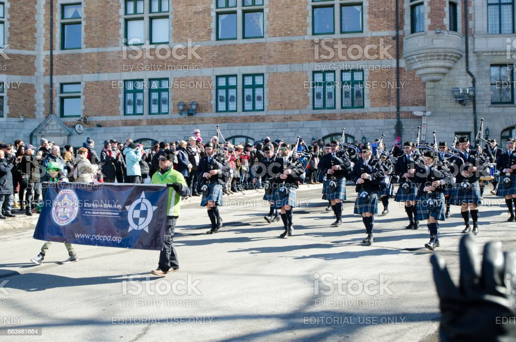 Marching Band of the Chicago Police with Bagpipes and drums at the Quebec St-Patrick's Parade stock photo