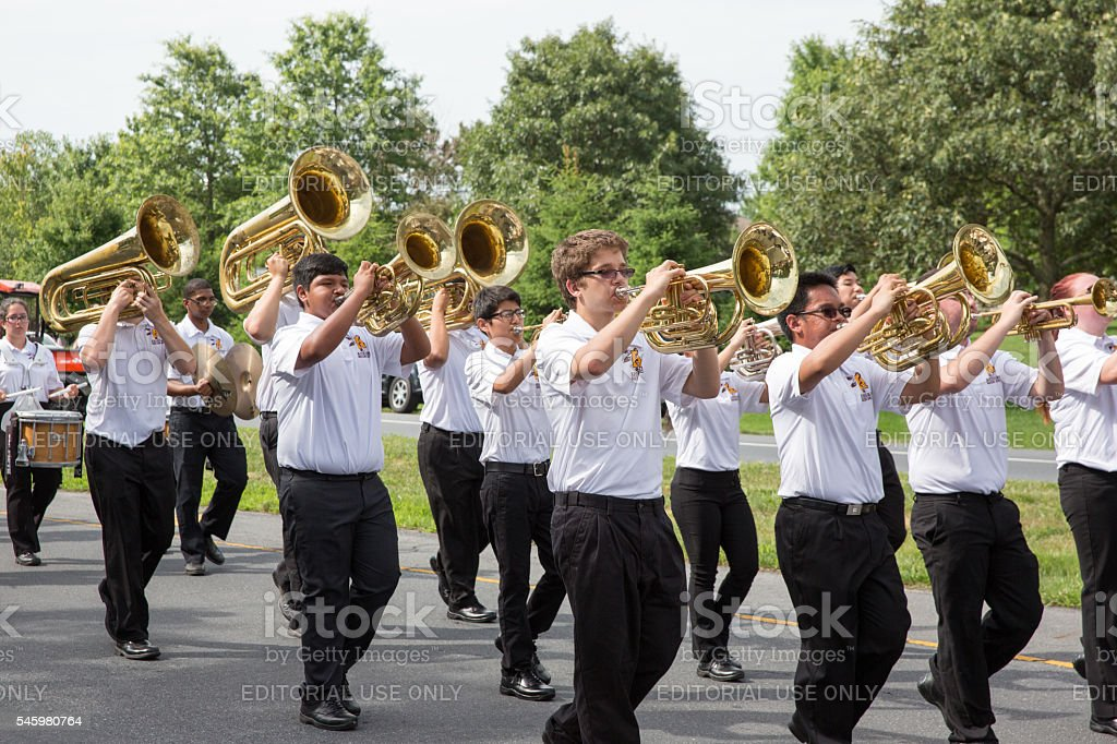 Marching band participating in a Fourth of July parade stock photo