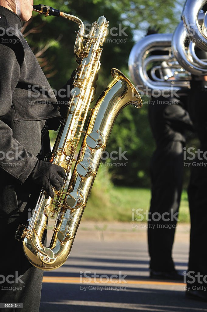 Marching Band Performer Playing Baritone saxophone in Parade stock photo