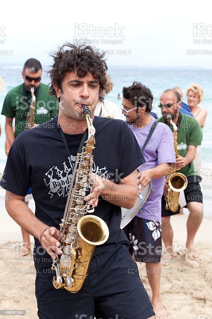 Marching Band performing on the Beach:sax is playing stock photo