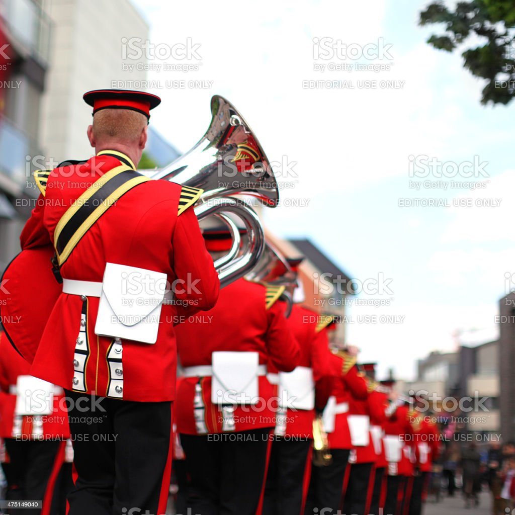 Marching Brass Band In Red Uniform at the Parade stock photo