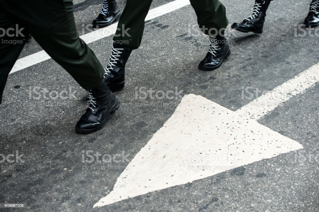 Marching military boots stock photo